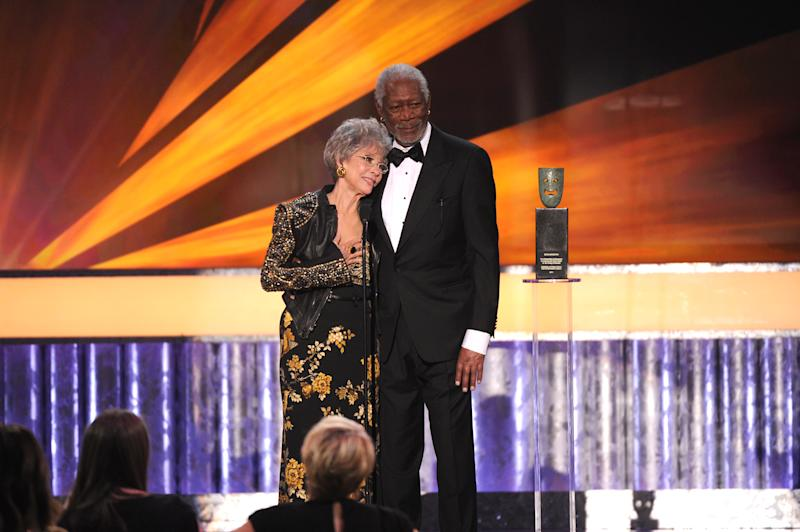 Morgan Freeman, right, presents Rita Moreno with the Screen Actors Guild 50th Annual Life Achievement Award at the 20th annual Screen Actors Guild Awards at the Shrine Auditorium on Saturday, Jan. 18, 2014, in Los Angeles. (Photo by Frank Micelotta/Invision/AP)