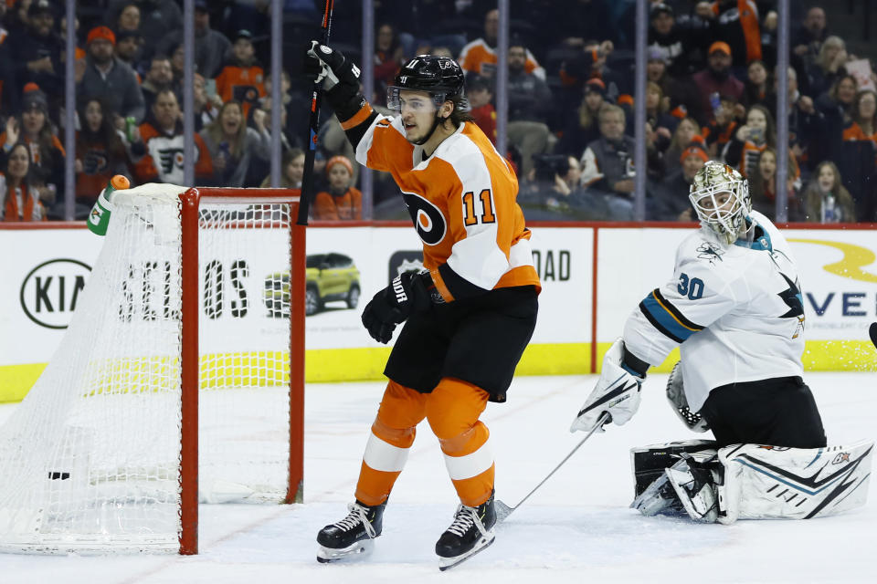 Philadelphia Flyers' Travis Konecny (11) celebrates after scoring a goal against San Jose Sharks' Aaron Dell (30) during the second period of an NHL hockey game, Tuesday, Feb. 25, 2020, in Philadelphia. (AP Photo/Matt Slocum)