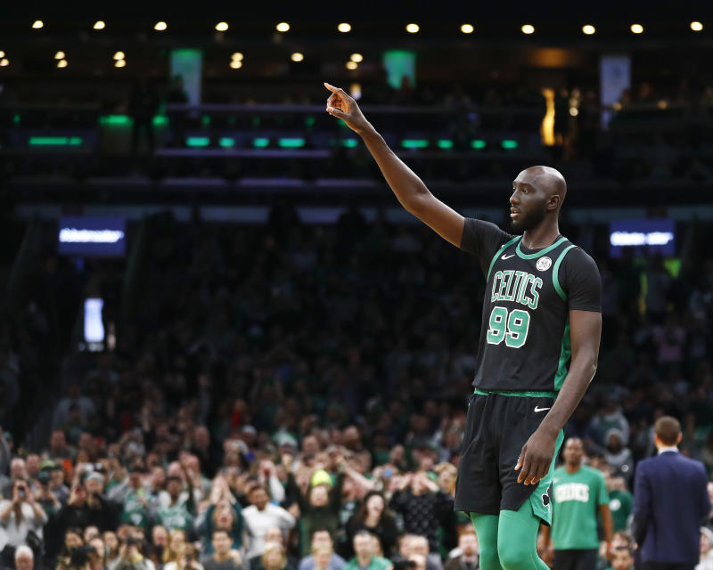 BOSTON, MASSACHUSETTS - DECEMBER 22: Tacko Fall #99 of the Boston Celtics reacts during the fourth quarter of the game against the Charlotte Hornets at TD Garden on December 22, 2019 in Boston, Massachusetts. NOTE TO USER: User expressly acknowledges and agrees that, by downloading and or using this photograph, User is consenting to the terms and conditions of the Getty Images License Agreement. (Photo by Omar Rawlings/Getty Images)
