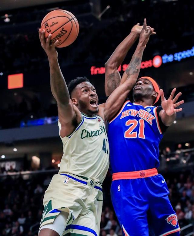 Milwaukee Bucks forward Thanasis Antetokounmpo of Greece (L) shoots on New York Knicks guard Damyean Dotson (R) during the NBA game between the New York Knicks and the Milwaukee Bucks at Fiserv Forum in Milwaukee, Wisconsin, USA, 02 December 2019. EFE/EPA/TANNEN MAURY