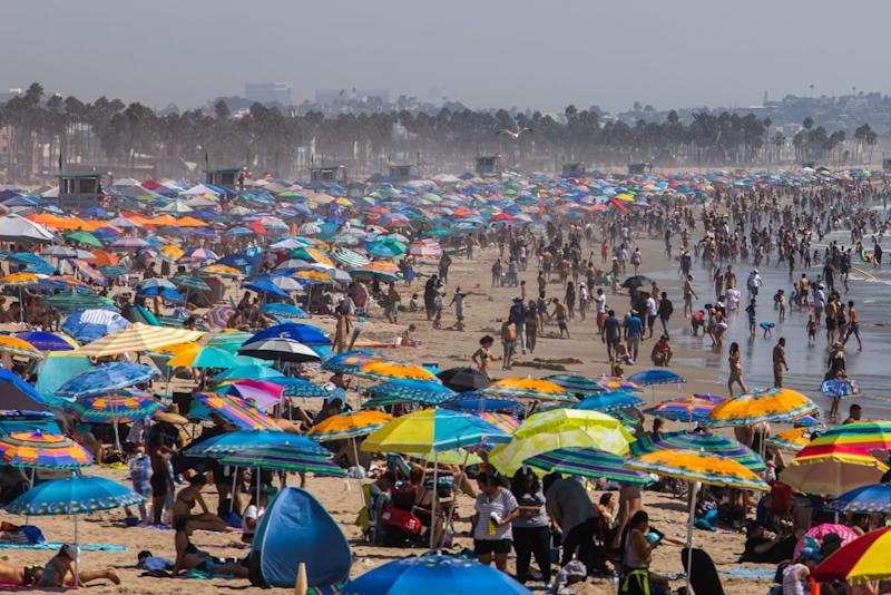 People gather on the beach on the second day of the Labor Day weekend amid a heatwave in Santa Monica, Caifornia. Source: Getty