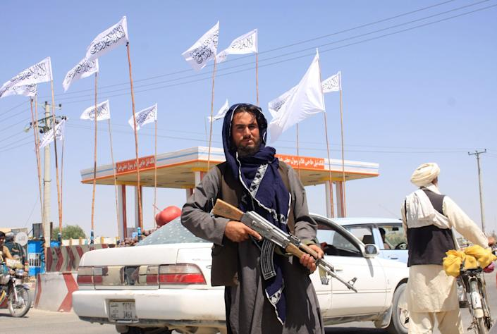 A Taliban fighter looks on as he stands at the city of Ghazni, Afghanistan.