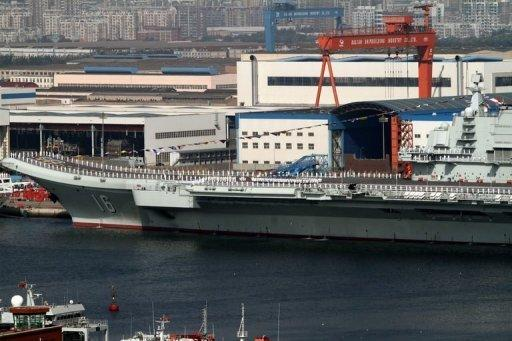 China's first aircraft carrier, the Liaoning sits berthed at the naval base in Dalian, northeast China's Liaoning province. The former Soviet ship, bought from Ukraine and refurbished, entered service on September 25, according to the defence ministry in Beijing