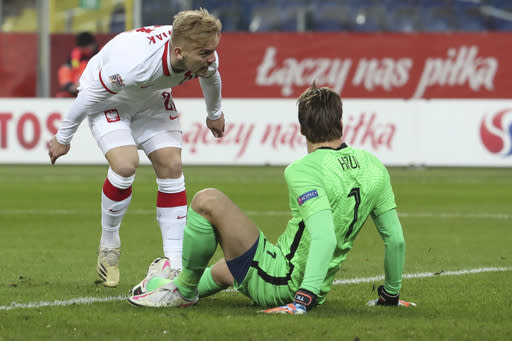 Poland's Kamil Jozwiak watches his shot go into the goal via the post after passing Netherlands' goalkeeper Tim Krul to score his side's first goal during the Nations League soccer match between Poland and The Netherlands at Silesian Stadium in Chorzow, Poland, Wednesday, Nov. 18, 2020. (AP Photo/Czarek Sokolowski)