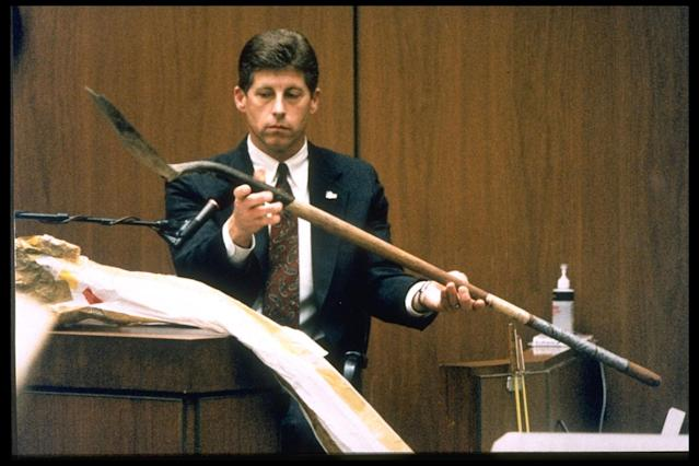 <p>Los Angeles Police detective Mark Fuhrman holds up the shovel found in O.J. Simpson's Ford Bronco during the investigation into the murders of Ron Goldman and Nicole Brown Simpson while testifying for the prosecution in Los Angeles,10 March 10, 1995. (Photo: Ted Soqui/Sygma via Getty Images) </p>