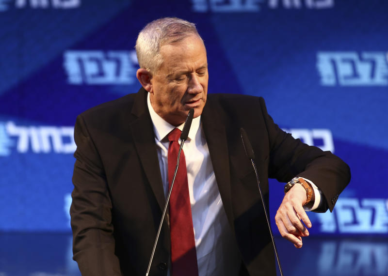 FILE - In this Sunday, Sept 15, 2019 file photo, Blue and White party chief, Benny Gantz, attends an election campaign in Tel Aviv, Israel. For the second time this year, Israel's long-serving Prime Minister Benjamin Netanyahu faces off again against Gantz, a former military chief, in national elections. Opinion polls show Netanyahu's Likud and Gantz's Blue and White locked in a close battle. (AP Photo/Oded Balilty, File)