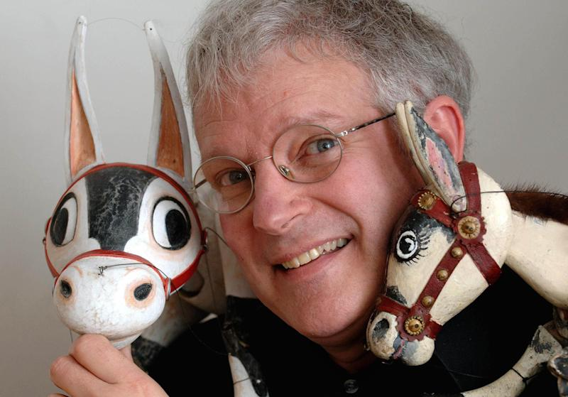 Puppeteer Ronnie Le Drew with the new Muffin the Mule puppet, left, and the original version of the puppet which was the first children's television character on the BBC 60 years ago.