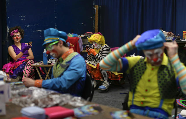 """<p>Ringling Bros. clowns take a break between acts in """"Clown Alley,"""" a private area backstage, Friday, May 5, 2017, in Providence, R.I. Clown Alley is not just a place: the private area backstage where clowns get ready to perform. It's how the clowns refer to themselves, a mini-fraternity within the circus, and a microcosm of it. (Photo: Julie Jacobson/AP) </p>"""
