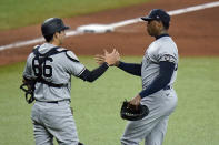 New York Yankees relief pitcher Aroldis Chapman shakes hands with catcher Kyle Higashioka (66) after closing out the Tampa Bay Rays during a baseball game Wednesday, May 12, 2021, in St. Petersburg, Fla. (AP Photo/Chris O'Meara)
