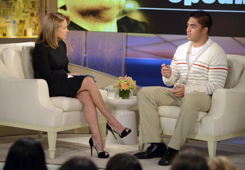 "In this photo taken on Jan. 22, 2013 and released by ABC Notre Dame linebacker Manti Te'o, right, speaking with host Katie Couric during an interview for ""Katie,"" in New York. Te'o has told Couric that he briefly lied about his online girlfriend after discovering she didn't exist, while maintaining that he had no part in creating the hoax. The interview will air on Thursday, Jan. 24.  (AP Photo/Disney-ABC, Lorenzo Bevilaqua)"