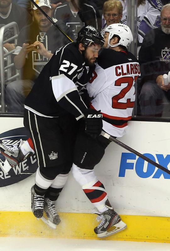 LOS ANGELES, CA - JUNE 11: Alec Martinez #27 of the Los Angeles Kings checks David Clarkson #23 of the New Jersey Devils in the second period of Game Six of the 2012 Stanley Cup Final at Staples Center on June 11, 2012 in Los Angeles, California. (Photo by Bruce Bennett/Getty Images)