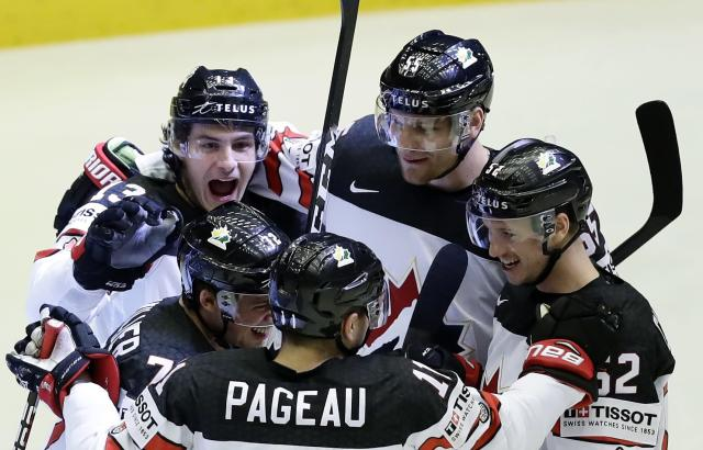 Ice Hockey - 2018 IIHF World Championships - Group B - Canada v Latvia - Jyske Bank Boxen - Herning, Denmark - May 14, 2018 - Anthony Beauvillier of Canada celebrates with teammates after scoring. REUTERS/David W Cerny