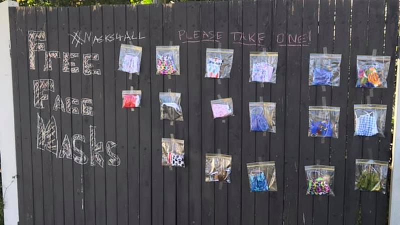 free masks on a wall in Brisbane for people who can't afford or find them.