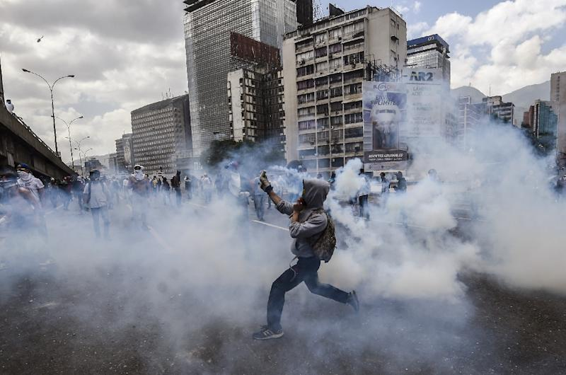 The opposition has vowed to continue protests against Venezuelan President Nicolas Maduro (AFP Photo/JUAN BARRETO)