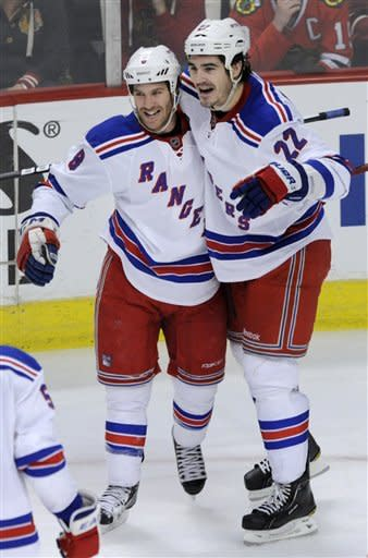 New York Rangers' Brandon Prust (8), celebrates with teammate Brian Boyle (22) after scoring against the Chicago Blackhawks during the third period of an NHL hockey game in Chicago, Friday, March 9, 2012. Chicago won 4-3. (AP Photo/Paul Beaty)