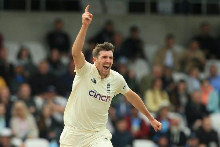 England's Craig Overton celebrates having India's KL Rahul caught for eight in the slips by Jonny Bairstow in the third Test at Headingley on Friday (AFP/Lindsey Parnaby)