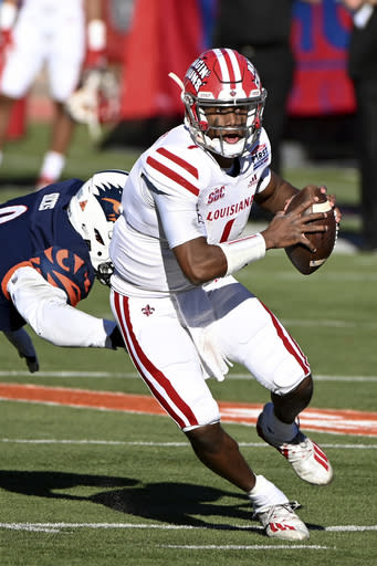 Louisiana-Lafayette quarterback Levi Lewis (1) gets away from UTSA's Clarence Hicks during the first quarter of the First Responder Bowl NCAA college football game in Dallas, Saturday, Dec. 26, 2020. (AP Photo/Matt Strasen)