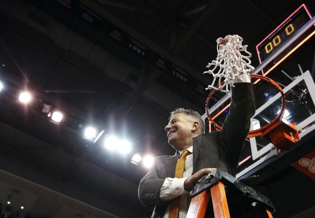 Auburn head coach Bruce Pearl cuts down the net after an NCAA college basketball game against South Carolina, Saturday, March 3, 2018, in Auburn, Ala. (AP Photo/Brynn Anderson)