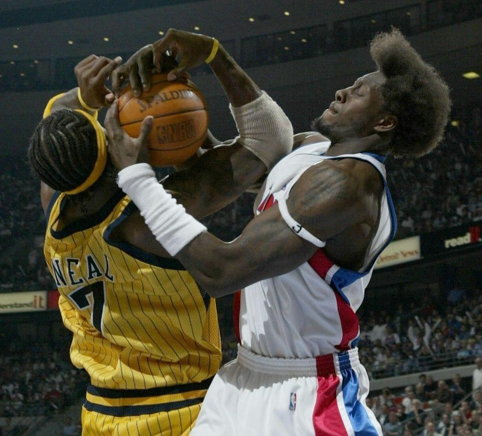 Detroit Pistons' Ben Wallace ties up Indiana Pacers' Jermaine O'Neal for a jump ball during the third quarter in Game 6 of the Eastern Conference finals June 1, 2004, at the Palace in Auburn Hills.
