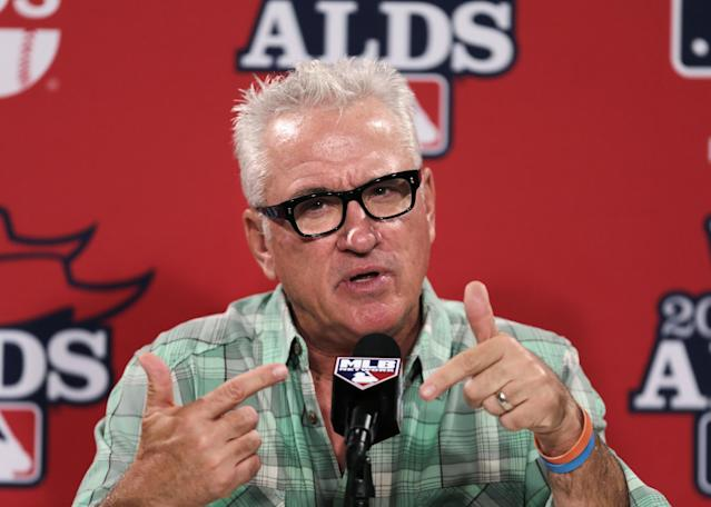 Tampa Bay Rays manager Joe Maddon talks with reporters prior to a baseball workout at Fenway Park, Thursday, Oct. 3, 2013, in Boston. The Tampa Bay Rays will face the Boston Red Sox in Game 1 of the American League division series on Friday. (AP Photo/Charles Krupa)