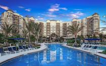 """<p>Apartment-style living at a wallet-friendly price is the highlight of <a href=""""https://www.groveresortorlando.com"""" rel=""""nofollow noopener"""" target=""""_blank"""" data-ylk=""""slk:The Grove Resort Orlando"""" class=""""link rapid-noclick-resp"""">The Grove Resort Orlando</a>. This resort's multi-bedroom suites make it easy to travel with large groups without paying for multiple hotel rooms, packing a punch for its price point. With Flip Flop's Game Room offering the latest and greatest in arcade entertainment, Surfari Water Park boasting FlowRider surf machines, dueling water slides, and a <a href=""""https://www.groveresortorlando.com/surfari/"""" rel=""""nofollow noopener"""" target=""""_blank"""" data-ylk=""""slk:700-foot lazy river"""" class=""""link rapid-noclick-resp"""">700-foot lazy river</a>, and even lakeside amenities for canoeing, kayaking or simply taking in the views, this resort's benefits rival on-property Disney hotels. It's a short drive to Walt Disney World, and though transportation is offered, we find it's best to use your own car while at The Grove Resort Orlando. An attached multi-level lot makes it seamless to come and go as you please, no matter what floor you reside on — just one of the many conveniences of this worthy multi-bedroom escape.</p>"""