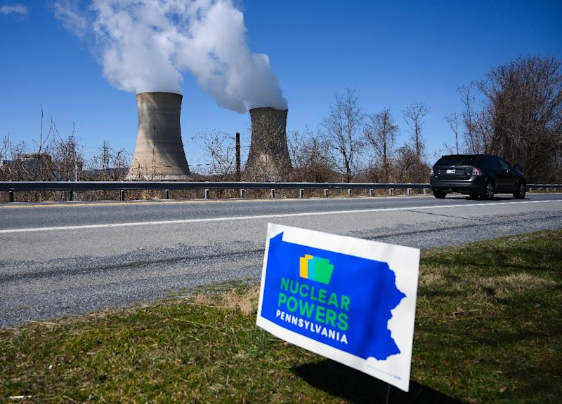 A sign supporting nuclear power with the Three Mile Island plant in the background (AFP Photo/ANDREW CABALLERO-REYNOLDS)