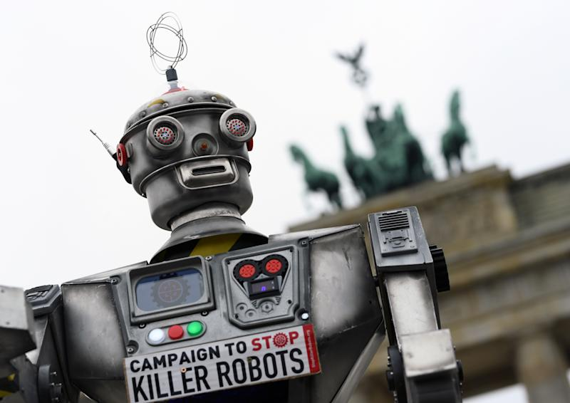 Activists from the Campaign to Stop Killer Robots, a coalition of non-governmental organisations opposing lethal autonomous weapons or so-called 'killer robots', stage a protest at Brandenburg Gate in Berlin, Germany, March, 21, 2019. REUTERS/Annegret Hilse