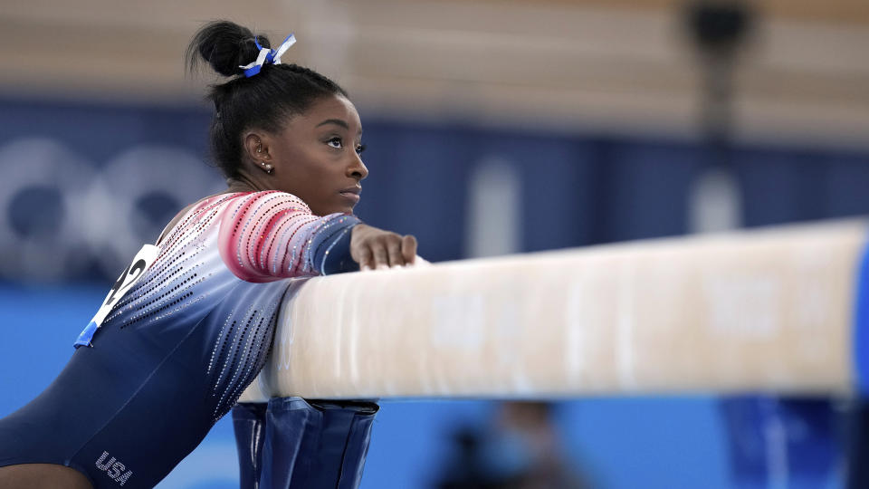 Simone Biles, of the United States, preparers to perform on the balance beam during the artistic gymnastics women's apparatus final at the 2020 Summer Olympics, Tuesday, Aug. 3, 2021, in Tokyo, Japan. (AP Photo/Natacha Pisarenko)