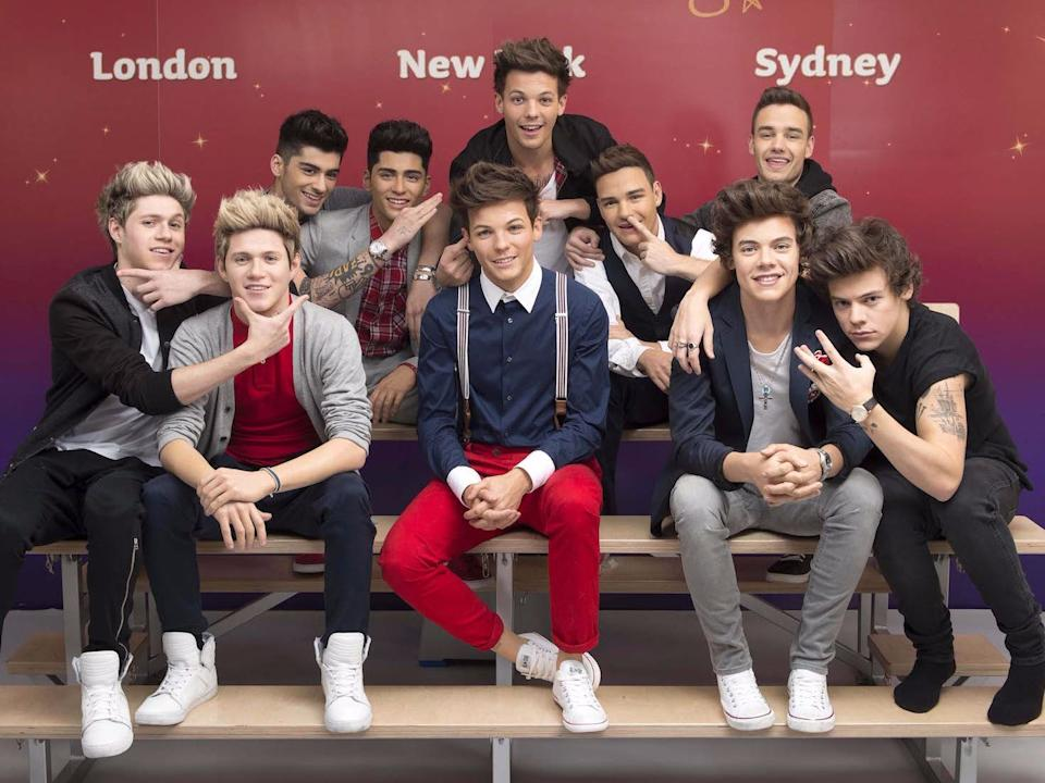 One Direction and their wax figures.