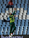 Pakistan's bowler Muhammad Nawaz jumps for the ball during the fourth and final T20 cricket match between South Africa and Pakistan at Centurion Park in Pretoria, South Africa, Friday, April 16, 2021. (AP Photo/Themba Hadebe)