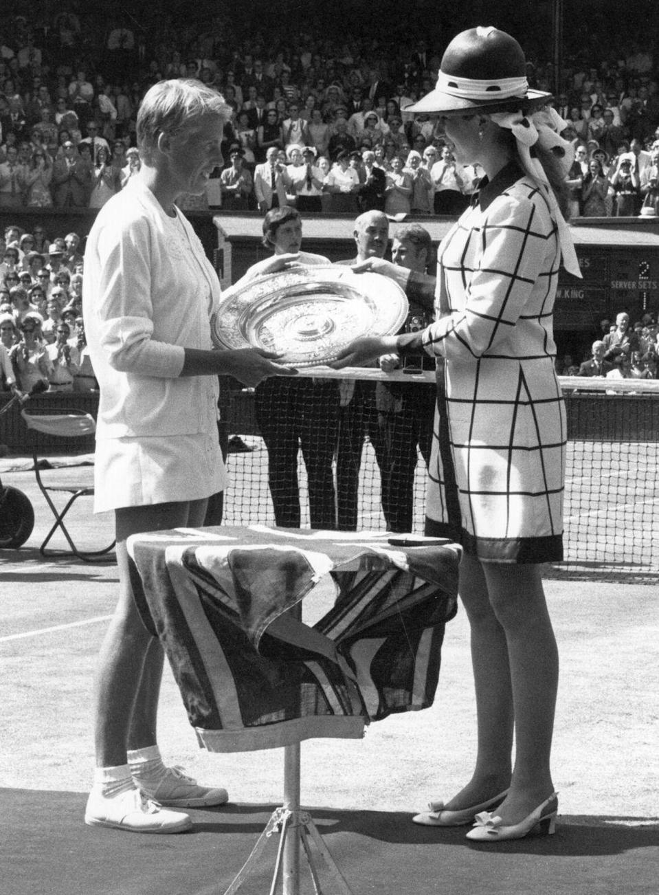 <p><strong>1969</strong> Princess Anne wore a checked mini dress and a statement hat for the tournament in 1969.</p>
