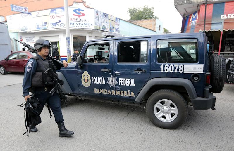 Mexican Federal Police patrol a street in Iguala, Guerrero state, Mexico on October 6, 2014 (AFP Photo/Pedro Pardo)