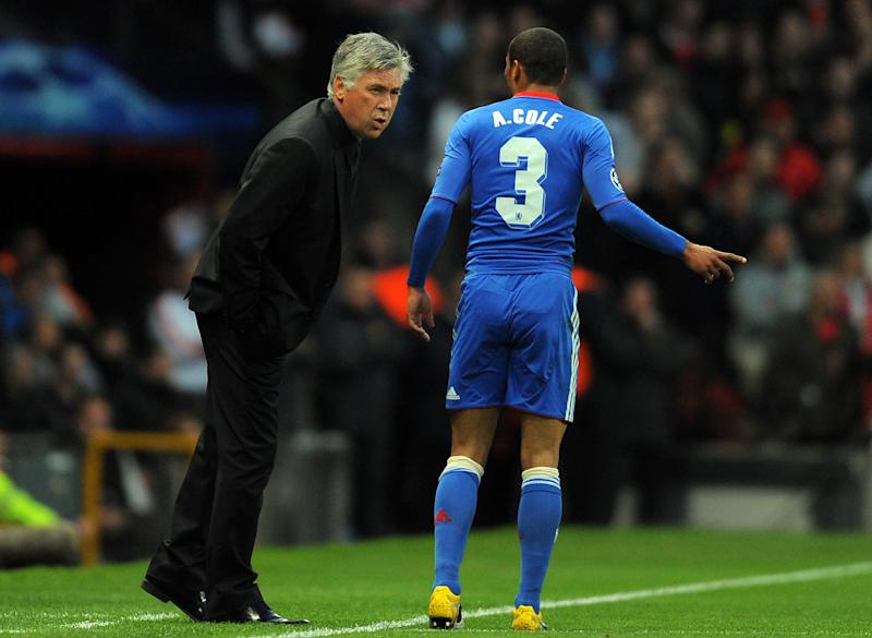 Chelsea's Italian manager Carlo Ancelotti (L) speaks to Chelsea's English defender Ashley Cole during their UEFA Champions League quarter final second leg football match against Manchester United at Old Trafford in Manchester, north west England, on April 12, 2011. AFP PHOTO/ANDREW YATES (Photo credit should read ANDREW YATES/AFP via Getty Images)