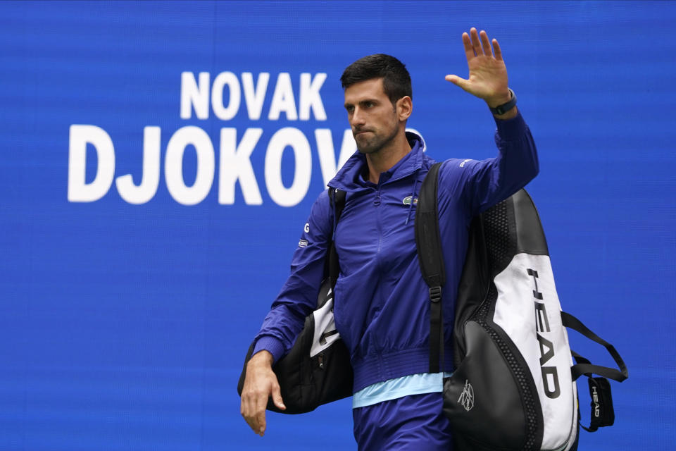 Novak Djokovic, of Serbia, walks onto the court to play against Daniil Medvedev, of Russia, in the men's singles final of the US Open tennis championships, Sunday, Sept. 12, 2021, in New York. (AP Photo/John Minchillo)