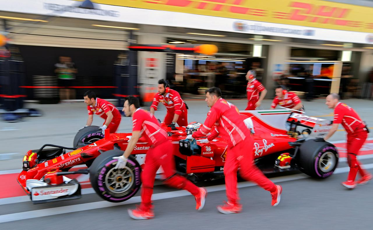 Formula One - F1 - Russian Grand Prix - Sochi, Russia - 29/04/17 - Mechanics push the car of Ferrari Formula One driver Kimi Raikkonen of Finland during the qualifying session. REUTERS/Yuri Kochetkov/Pool