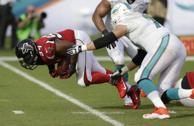 Atlanta Falcons defensive tackle Peria Jerry (94) recovers a fumble by Miami Dolphins quarterback Ryan Tannehill (17) during the second half of an NFL football game, Sunday, Sept. 22, 2013, in Miami Gardens, Fla. Dolphins tackle Tyson Clabo is at right. (AP Photo/Wilfredo Lee)