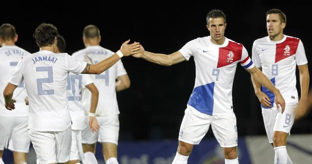 Netherlands' Robin Van Persie (9) celebrates with teammate Darryl Janmaat after scoring a goal against Andorra during their 2014 World Cup qualifying soccer match at Estadi Comunal in Andorra September 10, 2013. REUTERS/ Albert Gea (ANDORRA - Tags: SPORT SOCCER)