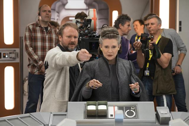 Rian Johnson and Carrie Fisher run through a scene in <i>The Last Jedi</i>. (Photo: Lucasfilm)