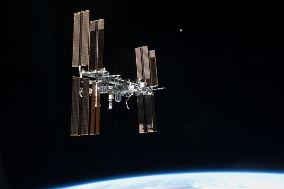 his picture of the International Space Station and the moon was photographed from the space shuttle Atlantis just after the two spacecraft undocked on July 19, 2011, during NASA's final shuttle mission STS-135.