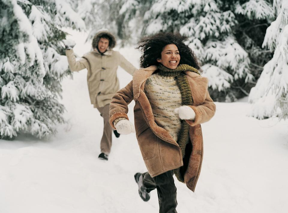 """<h1 class=""""title"""">Young Man Chasing a Woman in the Snow Holding a Snowball</h1><cite class=""""credit"""">Digital Vision.</cite>"""
