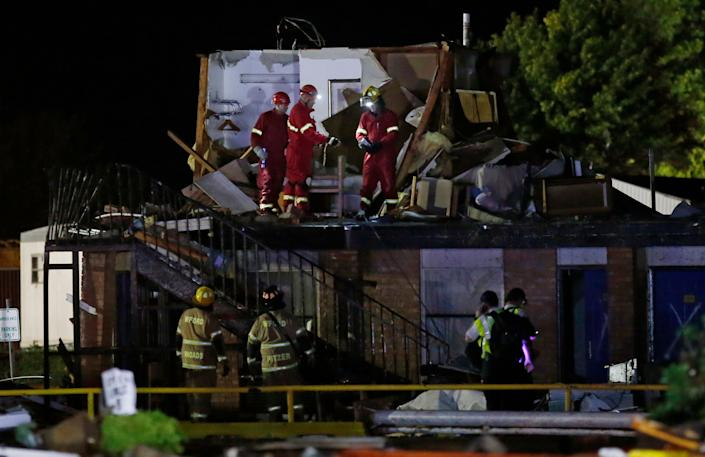 Emergency workers check what is left of the second floor of a hotel in El Reno, Okla., following a likely tornado touchdown on May 26. (Photo: Sue Ogrocki/AP)