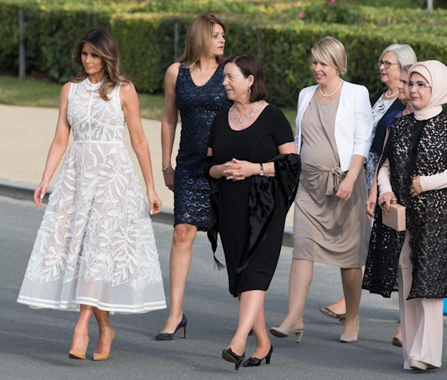 <p>Pictured at Parc du Cinquantenaire in Belgium, Melania wore a sheer, appliqued Elie Saab dress with nude heels. <br><em>[Photo: Rex]</em> </p>