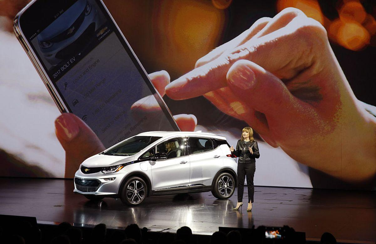 Mary Barra, chief executive officer of General Motors Co. (GM), unveils the Chevrolet Bolt electric vehicle (EV) during the 2016 Consumer Electronics Show (CES) in Las Vegas, Nevada, U.S., on Wednesday, Jan. 6, 2016. CES is expected to bring a range of announcements from major names in tech showcasing new developments in virtual reality, self-driving cars, drones, wearables, and the Internet of Things. Photographer: Patrick T. Fallon/Bloomberg via Getty Images