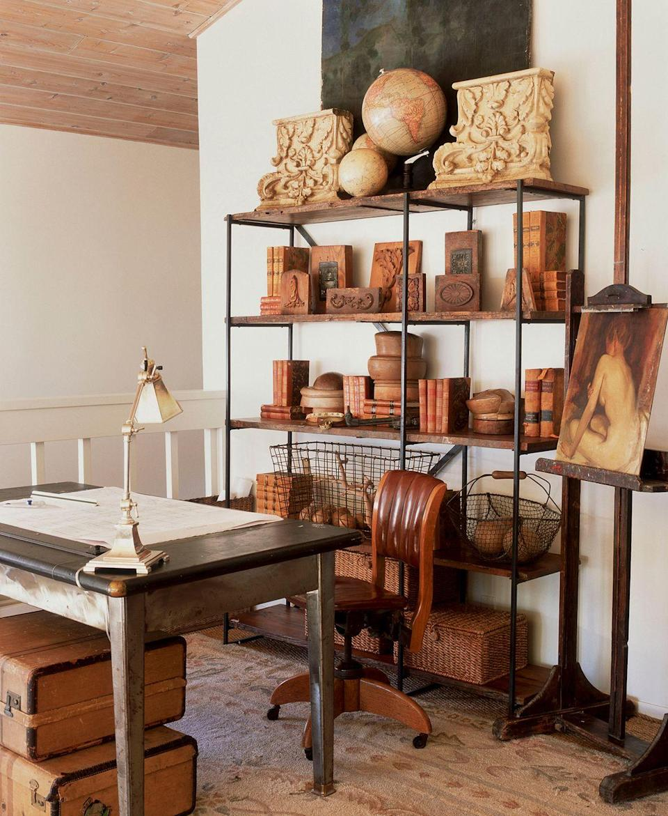 <p>Warm up a neutral home office by styling a bookshelf with wooden accessories, including art and decorative boxes.</p>
