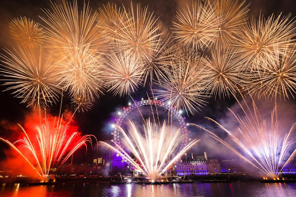 LONDON, UNITED KINGDOM - JANUARY 01: Fireworks light up the sky above the London Eye during the new year celebrations in London, United Kingdom on January 01, 2020.  (Photo by Vickie Flores/Anadolu Agency via Getty Images)