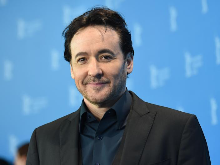 John Cusack at the 66th International Film Festival in Berlin, Germany, 16 February, 2016. (Photo by Britta Pedersen/picture alliance via Getty Images)
