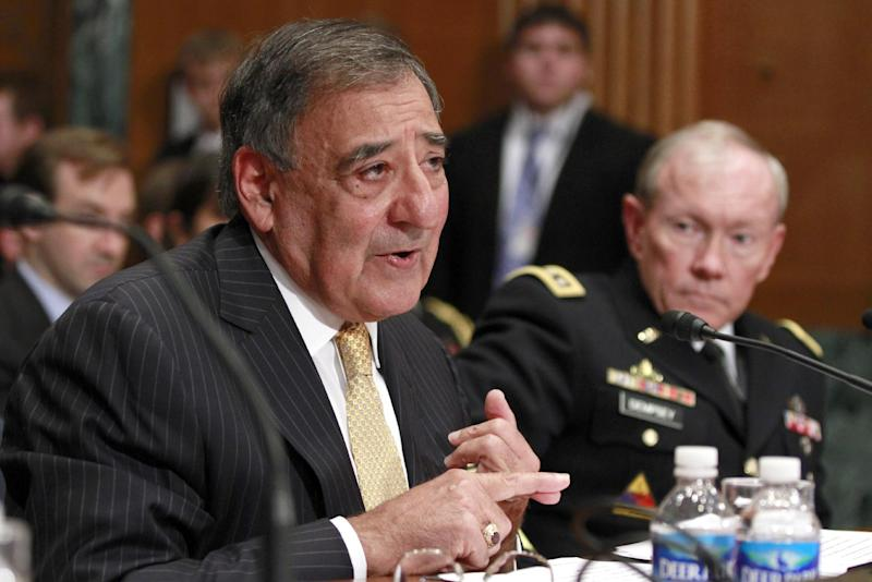 Defense Secretary Leon Panetta, left, accompanied by Joint Chefs Chairman Gen. Martin Dempsey testifies on Capitol Hill in Washington, Wednesday, June 13, 2012, before the Senate Defense subcommittee hearing on the the Defense Department's fiscal 2013 budget. (AP Photo/Jacquelyn Martin)