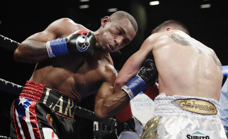 Erislandy Lara, left, punches Argentina's Brian Carlos Castano during the ninth round of a WBA super welterweight championship boxing match Saturday, March 2, 2019, in New York. The fight ended in a draw. (AP Photo/Frank Franklin II)