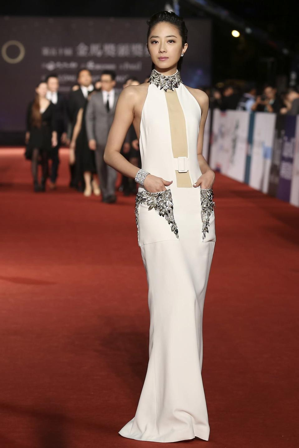 Taiwanese actress Gwei Lun-Mei poses for photographers on the red carpet at the 50th Golden Horse Film Awards in Taipei November 23, 2013. REUTERS/Patrick Lin (TAIWAN - Tags: ENTERTAINMENT)