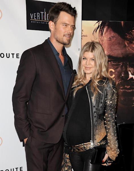 """Josh Duhamel, left and Fergie arrive at the premiere of """"Scenic Route"""" at the Chinese 6 Theater on Tuesday, Aug. 20, 2013 in Los Angeles. (Photo by Richard Shotwell/Invision/AP)"""